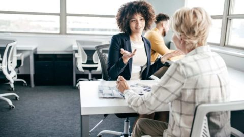 image of woman interviewing for sales job while currently employed